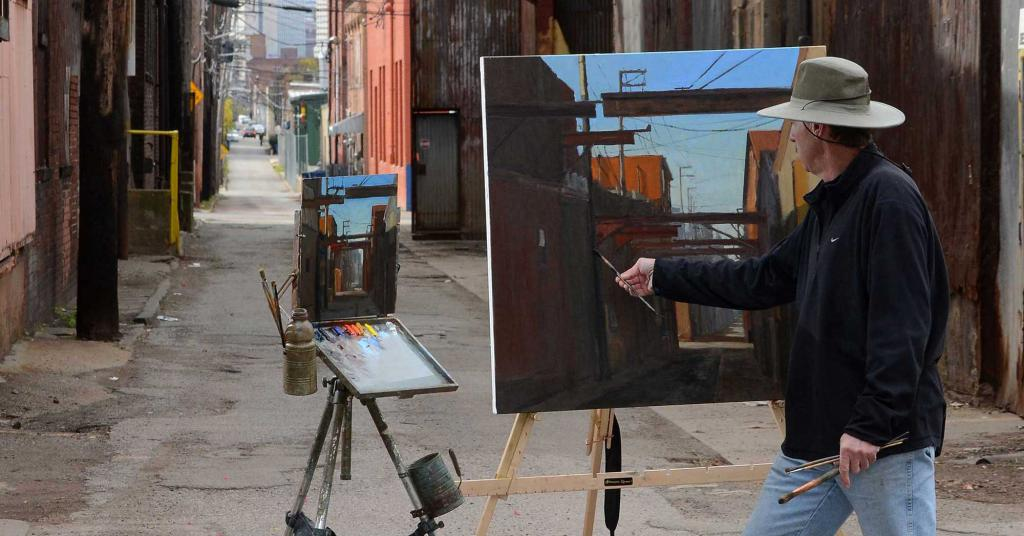 Художник рисующий на улице